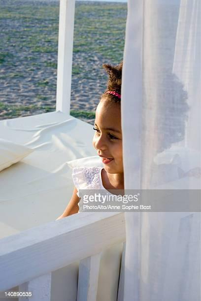 Little girl in curtained gazebo