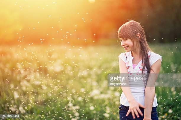 Little girl in dandelion field.