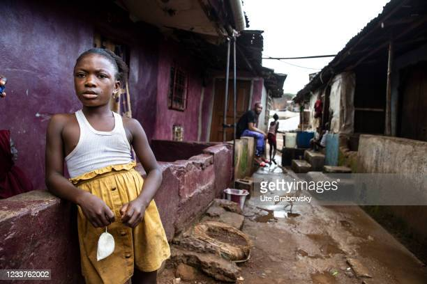 Little girl in dirty street of Bomeh Village on June 15, 2021 in Freetown, Sierra Leone. The poorest of the poor have started to settle on the waste...