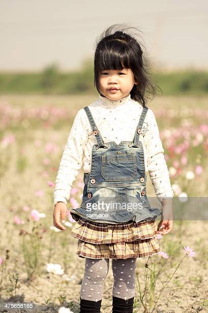 Little girl in flower field