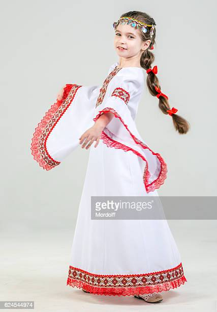 little girl in folk clothes - little russian girls stock photos and pictures