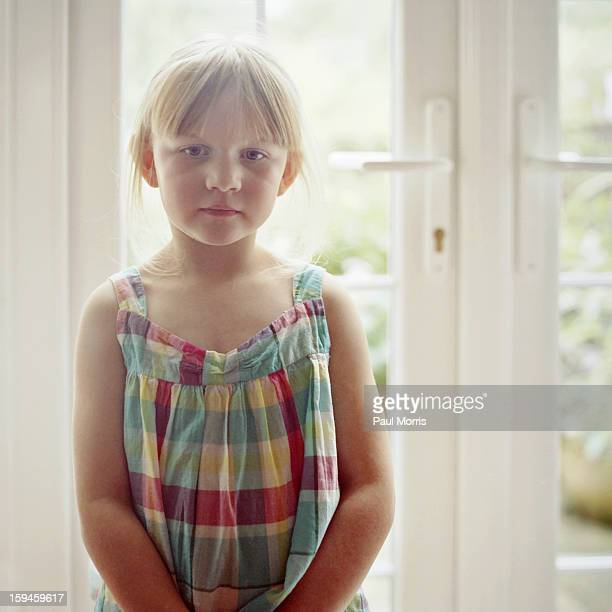 Little Girl in front of French Windows