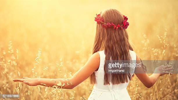 Little girl in grain field