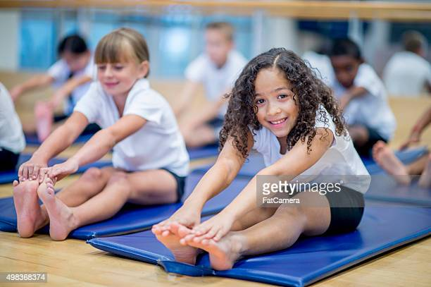 little girl in gym class - girl feet stock photos and pictures