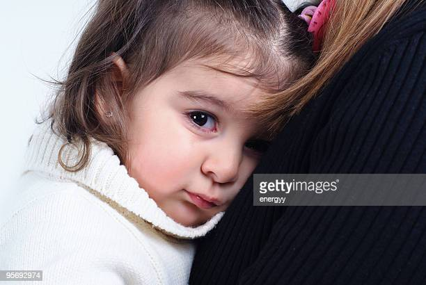 little girl in her mother's lap