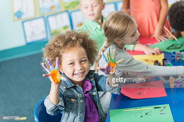 little girl in kindergarten class doing art project - children only stock pictures, royalty-free photos & images