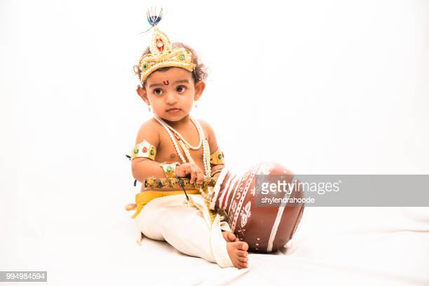 little girl in krishna dress - lord krishna stock photos and pictures