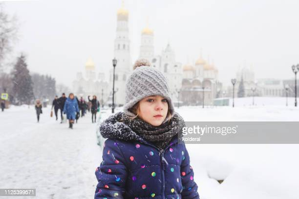 little girl in moscow kremlin - orthodox christmas stock pictures, royalty-free photos & images