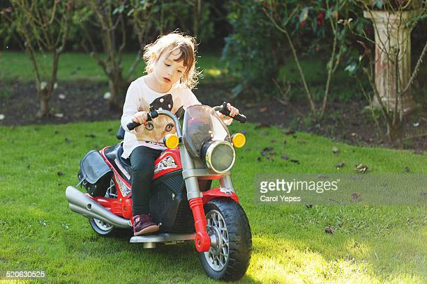 Little girl in motorbike