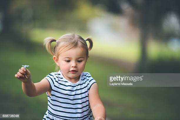Little Girl In Pigtails Running