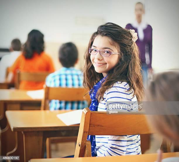 Little girl in school class.