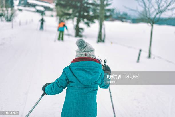 little girl in snowy winter landscape on cross-country-ski - nordic skiing event stock pictures, royalty-free photos & images