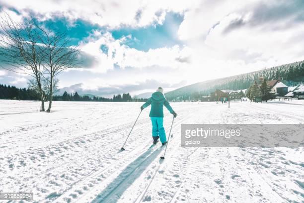 little girl in snowy winter landscape on cross-country-ski