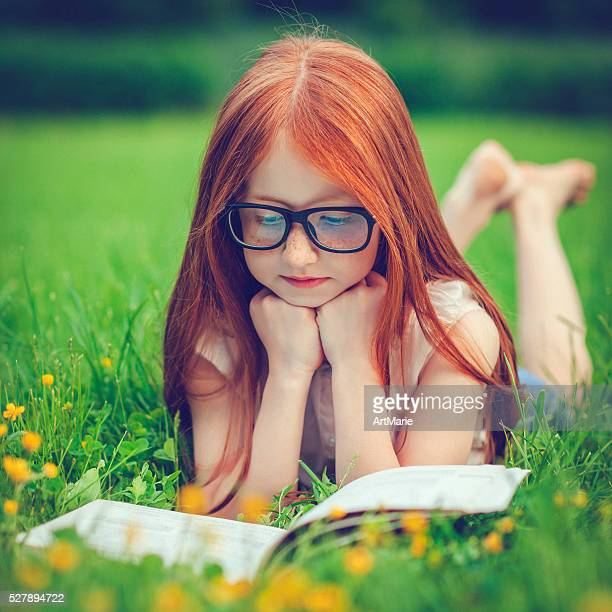 little girl in summer - redhead girl stock photos and pictures