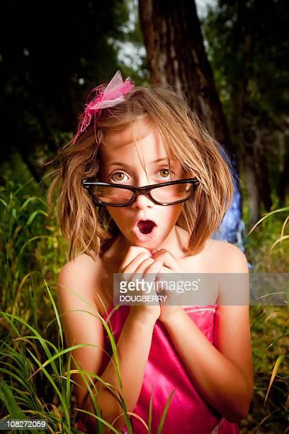 Little girl in tall grass