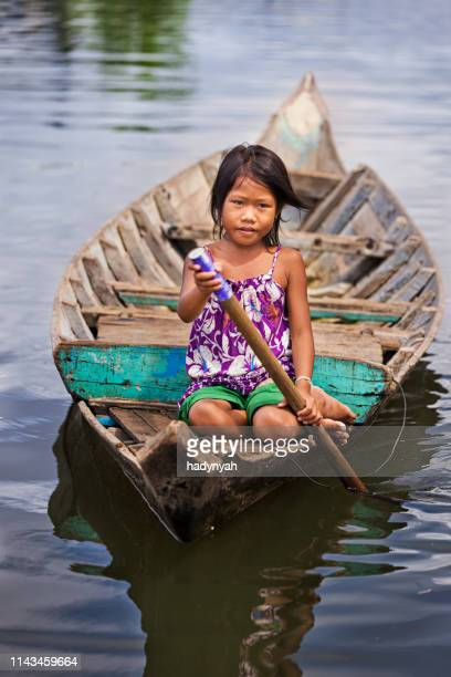 little girl in the boat, cambodia - traditionally cambodian stock pictures, royalty-free photos & images