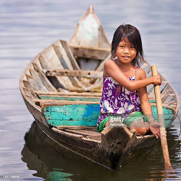 little girl in the boat, cambodia - cambodian culture stock photos and pictures