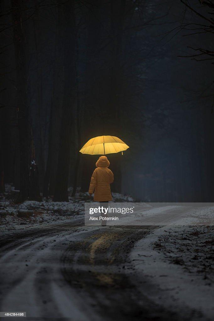 Little girl in the dark forest : Stock Photo
