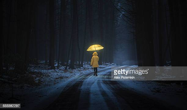 little girl in the dark forest - umbrella stock pictures, royalty-free photos & images