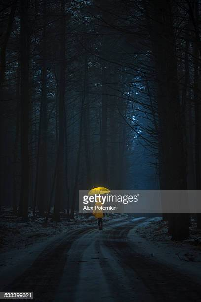 little girl in the dark forest - ugly girl stock photos and pictures