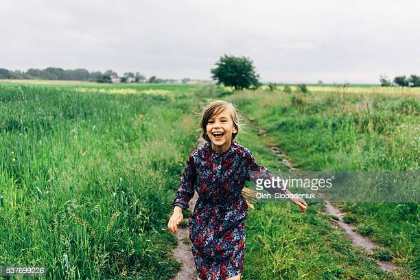 little girl in the field - ukraine stock pictures, royalty-free photos & images