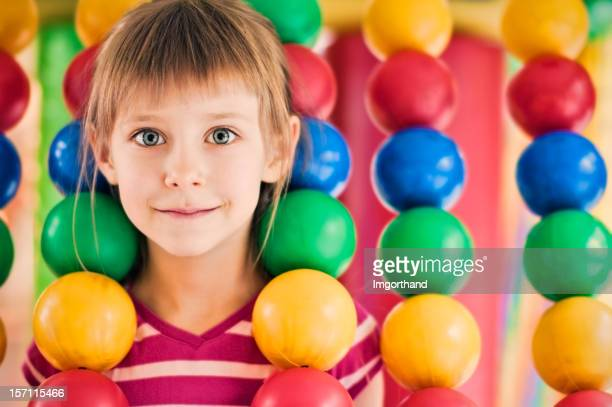 Little girl in the indoor playground