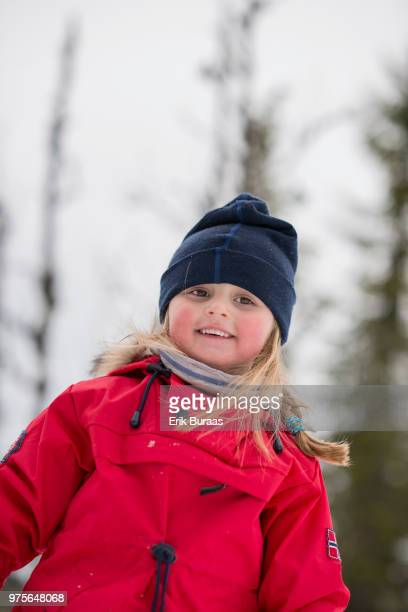 Little girl in the montain smiling