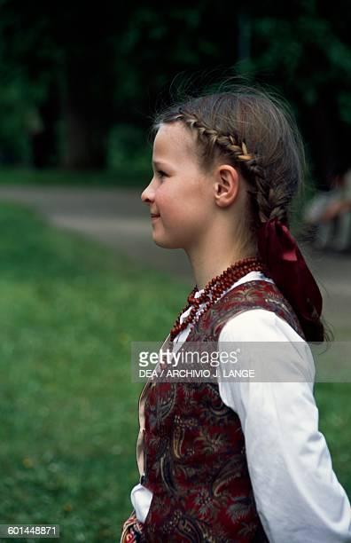 Little girl in traditional costume Vilnius Lithuania
