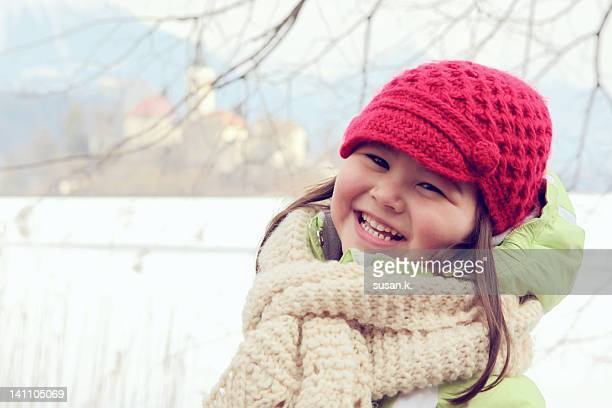 little girl in warm clothing - kranj fotografías e imágenes de stock