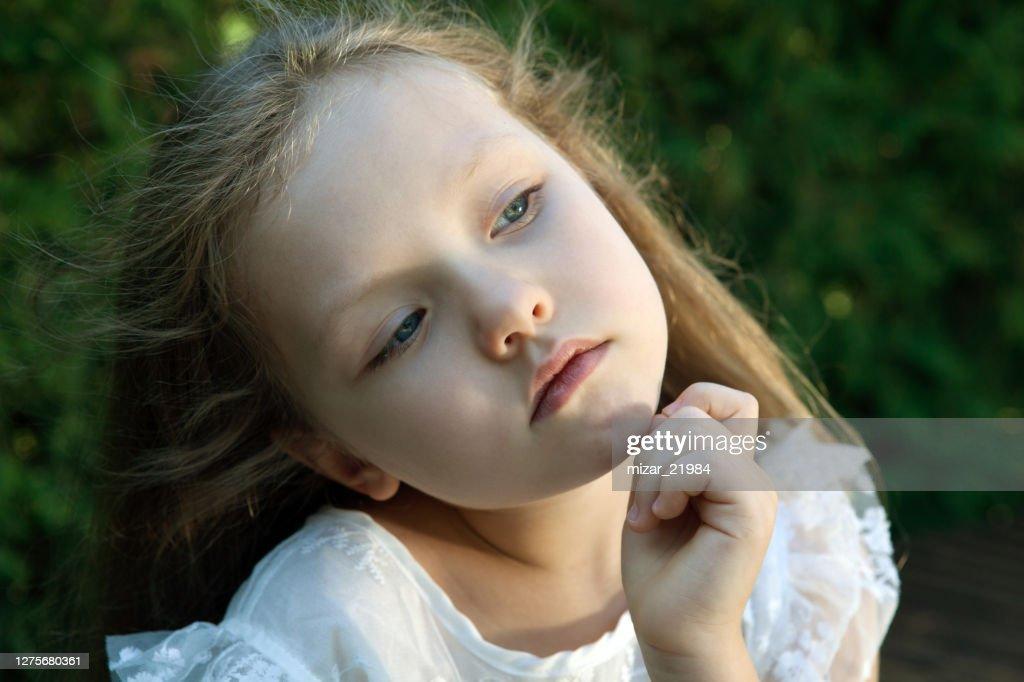 little girl in white dress smiling portrait : Stock Photo