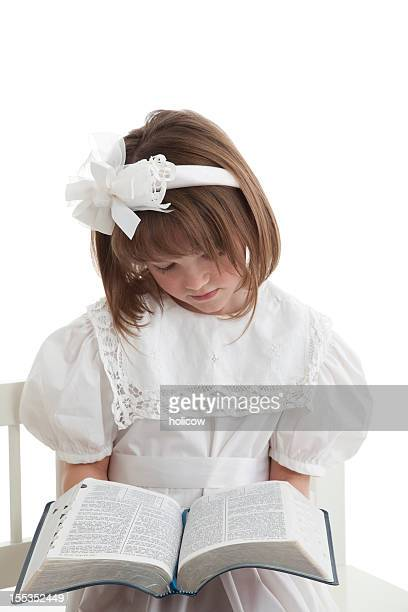 little girl in white reading her scriptures - bible photos stock pictures, royalty-free photos & images