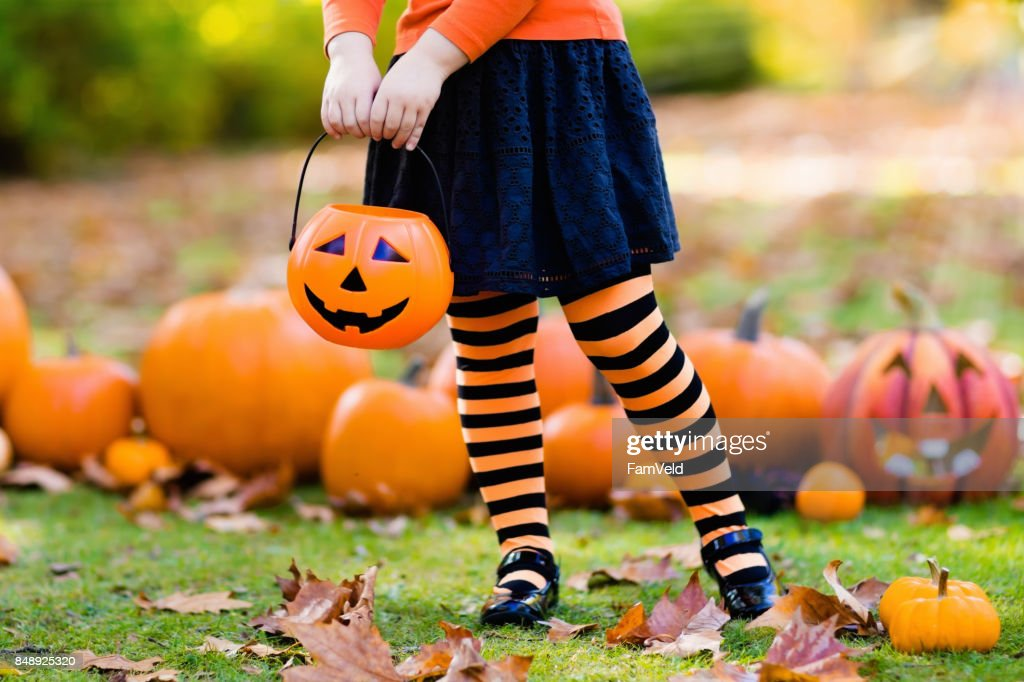 Little girl in witch costume on Halloween trick or treat : Stock Photo