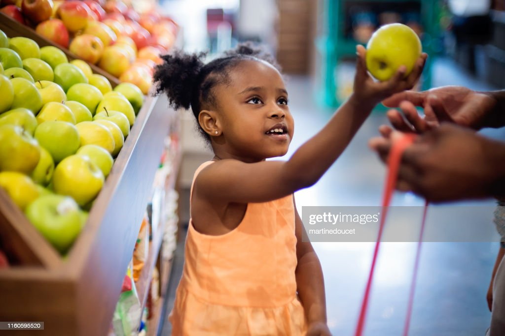 Little girl in zero waste oriented fruit and grocery store. : Stock Photo