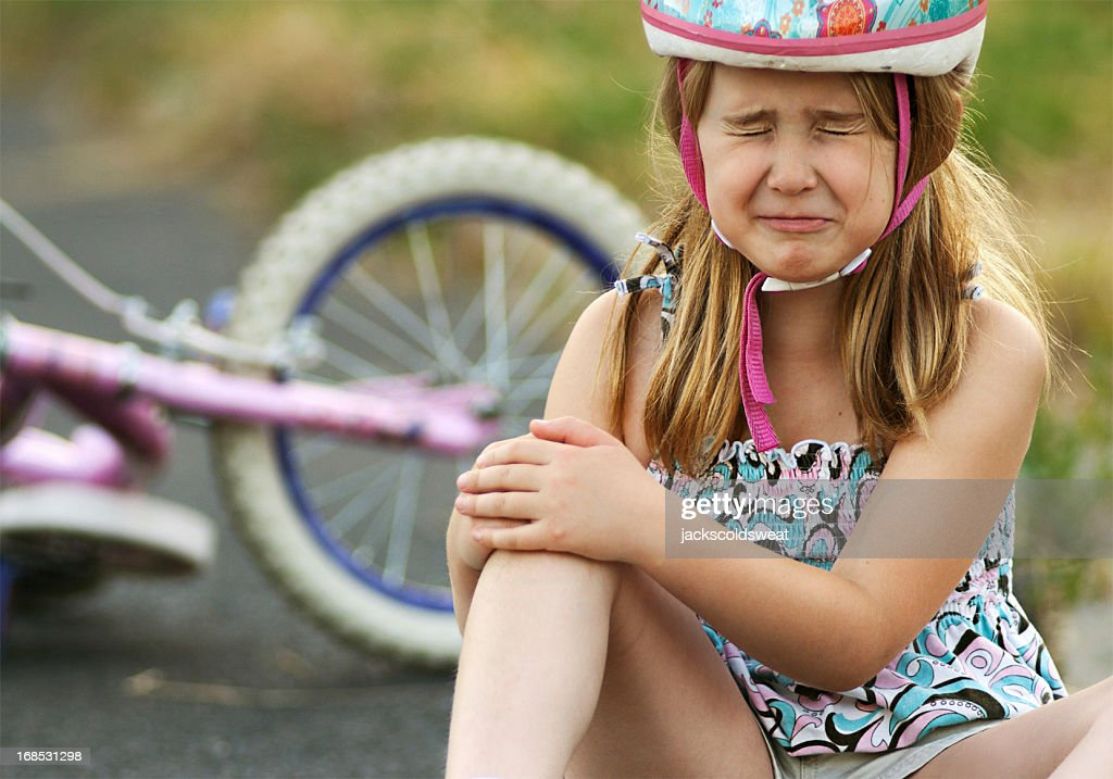 Little girl injured from bicycle crash : Stock Photo