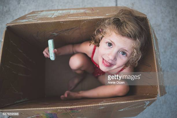 Little Girl inside a Box