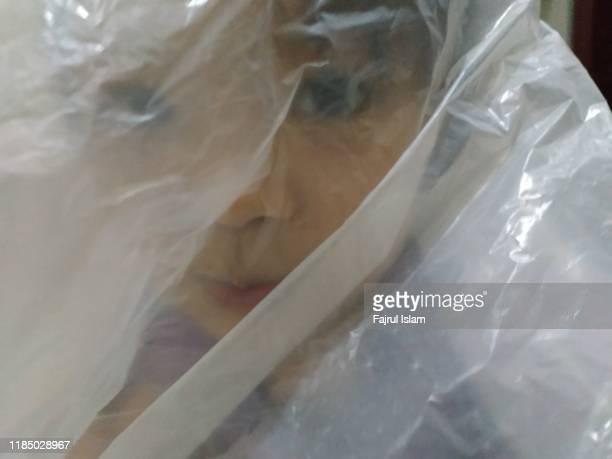 little girl inside plastic - 誘拐事件 ストックフォトと画像