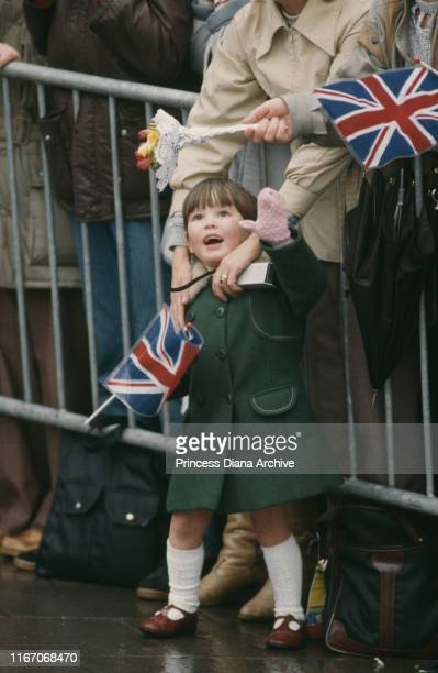 A little girl is excited to see Charles and Diana the Prince and Princess of Wales during their visit to Nottingham UK March 1985