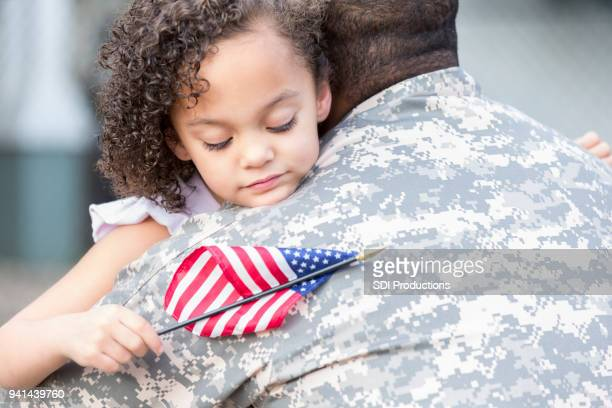 Little girl is glad to have her soldier daddy home