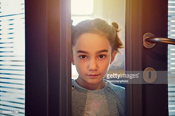Little girl is opening the living room door