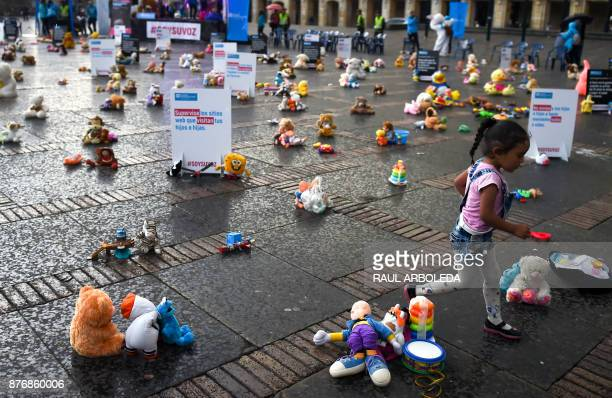 A little girl is pictured during an urban intervention at Bolivar square in Bogota to protest against child abuse and to raise awareness on...