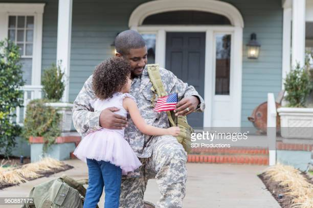 little girl is reunited with her army dad - military flags stock photos and pictures