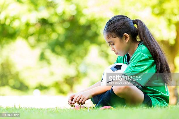little girl is sad after losing soccer game - disappointment stock pictures, royalty-free photos & images