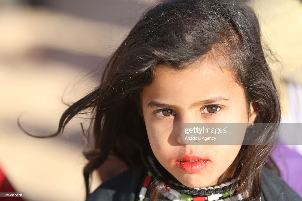 A little girl is seen as the participants perform shows, including traditional wedding ceremonies, folk dances and musics during the International Festival of the Sahara in Douz, Tunisia on December 27, 2014.