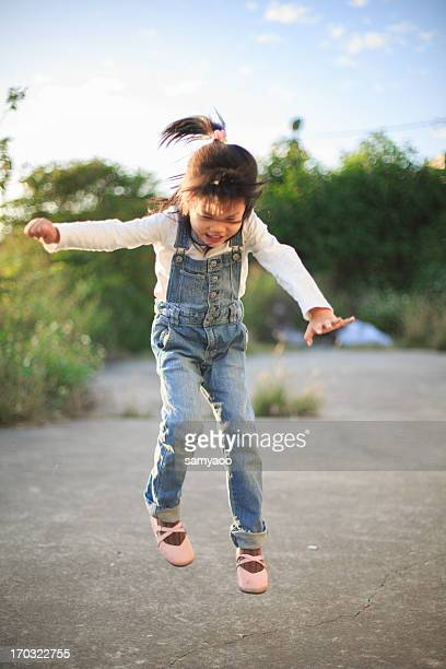 A little girl jumping in play ground