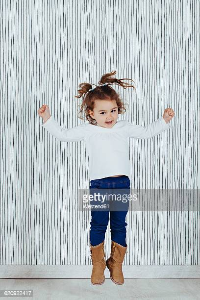 Little girl jumping in the air