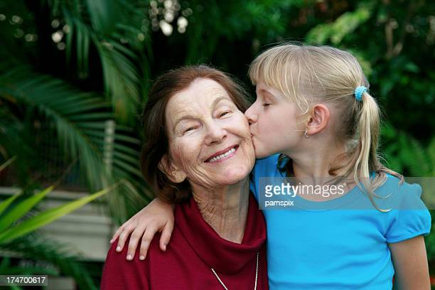 Little Girl Kissing Grandmother on the cheek