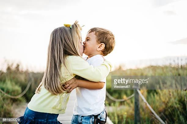 Little girl kissing her best friend