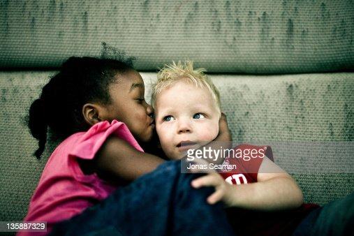 Little Girl Kissing Little Boy Stock Photo - Getty Images-5732