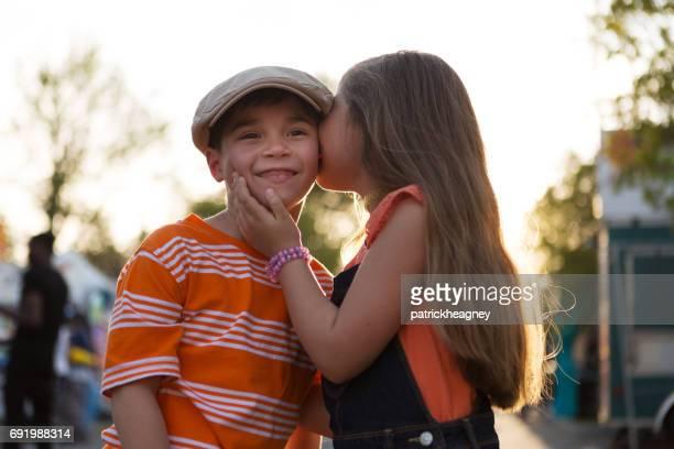 Little girl kissing little boy