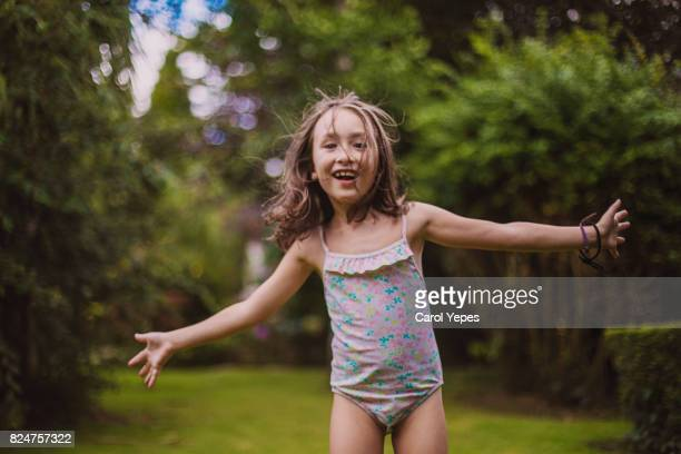 little girl laughing and running outdoors